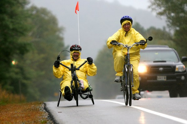 Amputee Joe Severs, left, of Highland, Ill., with wife Mary, bike in the rain on the first day last year of a three-day bike race in Franconia Notch, N.H. The ride is a fundraiser for Northeast Passage, a UNH program that offers sports and recreation activities for people with disabilities.