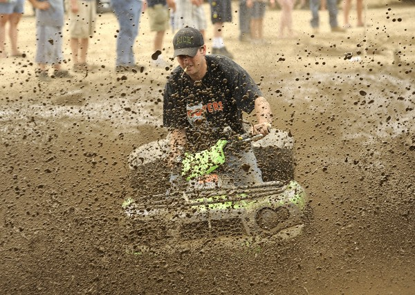 Glen Pomerleau of Poland navigates the mud pit on his all-terrain vehicle at the first Redneck Olympics in Hebron on Saturday.