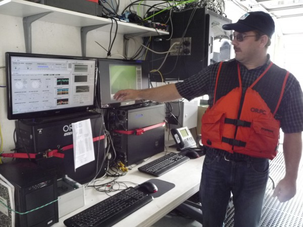 "Project Manager David Turner of Ocean Renewable Power Company explains the control system on the barge that is tethered to the underwater hydro-power turbine that has been in Cobscook Bay off Lubec for the past year and a half. The turbine will be replaced in the spring with a much larger turbine that will be attached to the ocean floor. ORPC is leading the world in hydro-power research. ""When we began, we didn't even know what questions we needed to ask,"" Turner said Friday during an open house on the barge at Eastport. ""No one else had done this before. Now, other companies are coming to us for answers."""