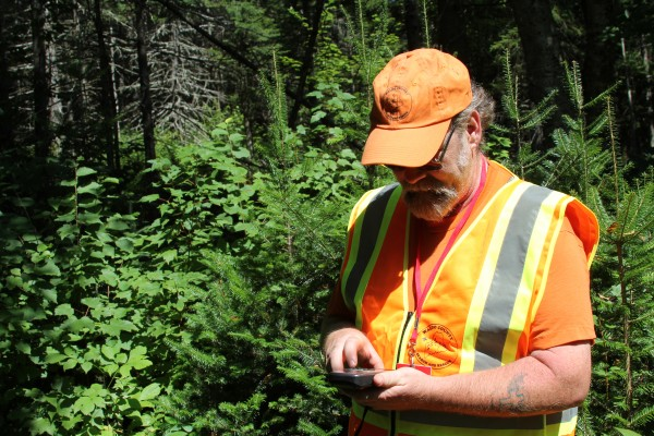 Wyman Bunker toys with his new GPS on Saturday during an emergency training program. Bunker is one of about 30 volunteers with Waldo County Search and Rescue.