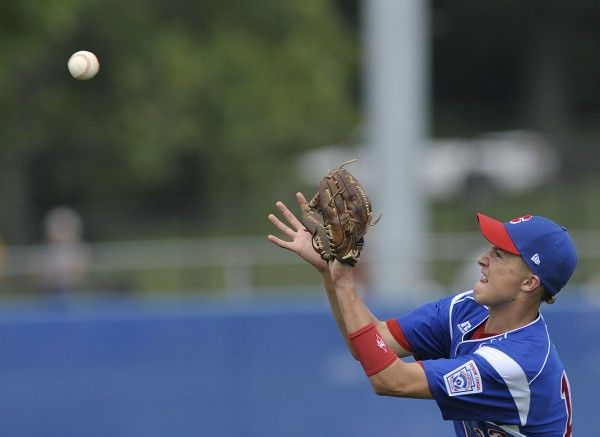 Canada right fielder Rafael Zapata draws a bead on a fly ball during the fifth inning of Sunday's Senior League World Series game against Brewer at Mansfield Stadium in Bangor.