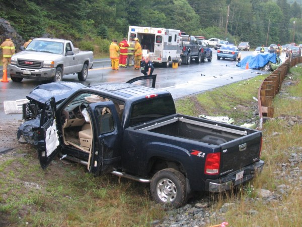 A truck driven by a Florida man collided head-on Tuesday with a Volkswagen Beetle, seen covered by a tarp at right in background, on Route 1 in Sullivan, according to Maine State Police. The driver of the Beetle, Sharon Rolfe, 62, of Milbridge, died in the accident, police said.