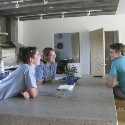 TerraHaus Resident Assistant Ashley Sutton, student Katie Papoulias and resident Melissa Merritt talk Friday in the Unity College building's kitchen area. Students are moving in this week to the new, eco-friendly building.