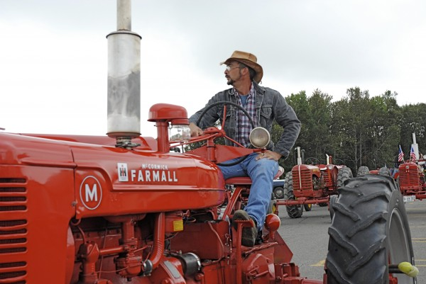 Clayton Turner listens to some last-minute instructions before joining the line of tractors taking part in Sunday's Antique Tractor Trek to benefit Hospice of Aroostook. Seventeen tractors and drivers with the northern Maine chapter of the Antique Tractor Club of Maine took part in the event, raising close to $2,000.