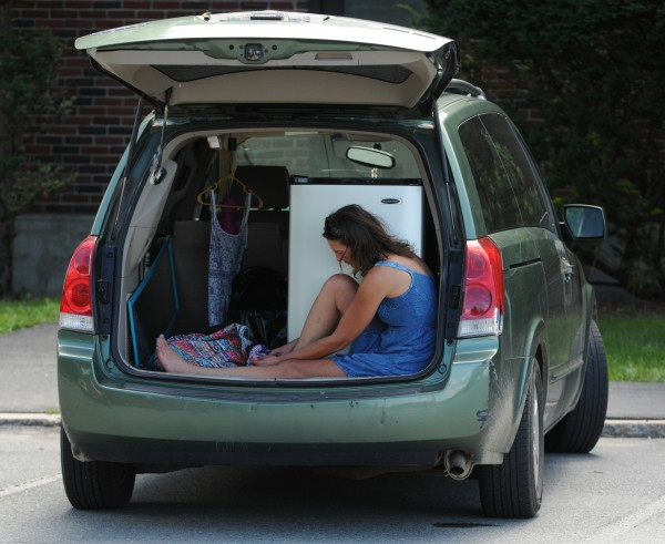 Beth Maiorana of Kittery sits in the back of her van waiting for help to move her daughter's mini fridge into Gannett Hall on the University of Maine campus in Orono on Friday, Aug. 26, 2011 during move in day.