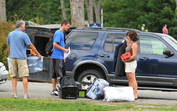 Joe Viola, center, gets help from his parents, Bob, left, and Peggy, right , while moving his belongings into Oxford Hall on the University of Maine campus in Orono on Friday, Aug. 26, 2011 during move in day.