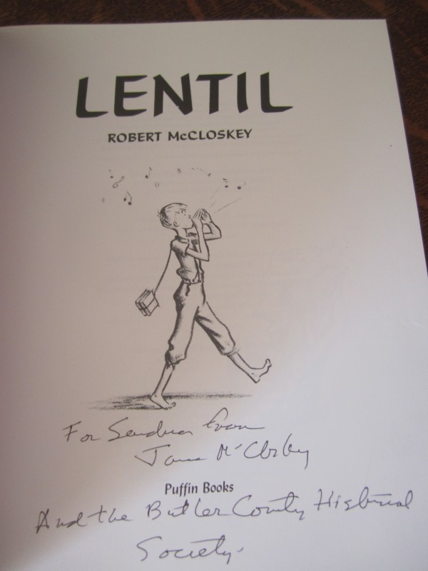 "Title page of Robert McCloskey's book, ""Lentil,"" based on his hometown of Hamilton, Ohio. The inscription is from Jane McCloskey to Mindy Blake's cousin Sandra, a guide in the McCloskey museum in Hamilton."