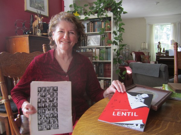 Mindy Blake with her mother's high school yearbook from Hamilton, Ohio.  Mindy's mother and Robert McCloskey's sister are pictured on the same page and were high school friends. In Mindy's other hand is a Robert McCloskey book inscribed by the author's daughter.