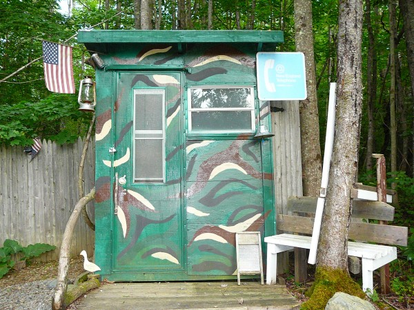 Here is our outhouse. We have a fire pit outback of our house and my wife got tired of walking back to the house to go to the bathroom. So her father built this for us. It has two seats one for adults and one a little lower for kids. Its camo and has a bell to ring to see if anyone is in it.