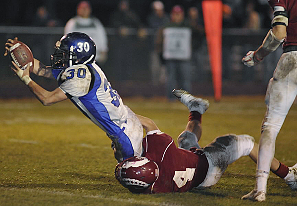 Bangor High School co-captain Dylan Morris couldn't stop Lewiston High School's Joe McKinnon as he dove into end zone to score during a game last season. Lewiston has been picked by BDN sportswriter Ernie Clark to win the Eastern Maine Class A title this season.