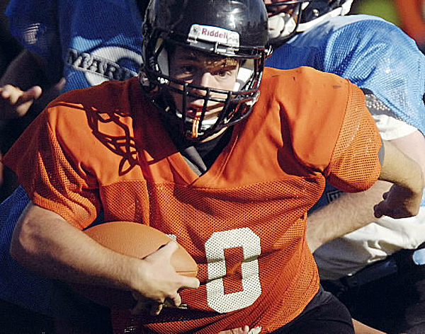 Brewer High School's Brody Valley (10) breaks through the Oceanside line during a preseason scrimmage in Brewer. The Witches open their season