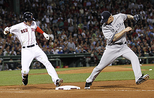 New York Yankees starting pitcher A.J. Burnett misses the bag as Boston Red Sox's Jacoby Ellsbury is safe on an infield hit during the fifth inning of a baseball game at Fenway Park in Boston Thursday night.