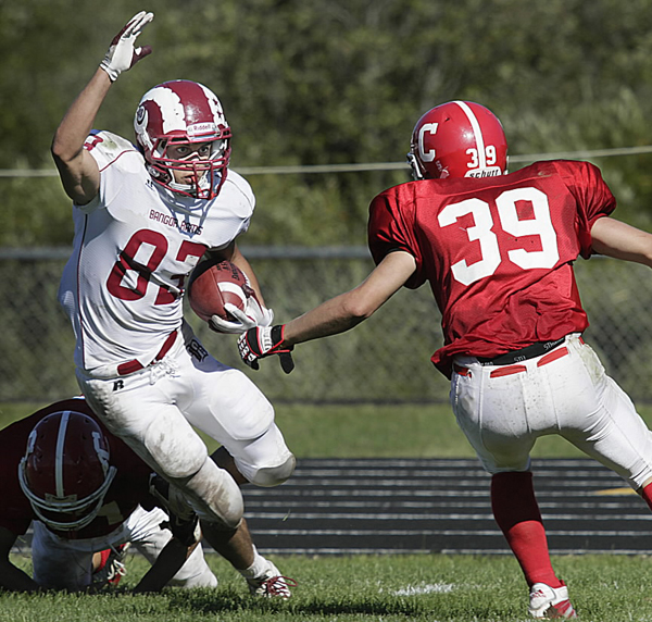 Bangor's Nick Sherwood avoids one tackler and runs around Cony's John Hall en route to a touchdown during a game last season. Sherwood and the Bangor Rams open their season Friday night in Brunswick.
