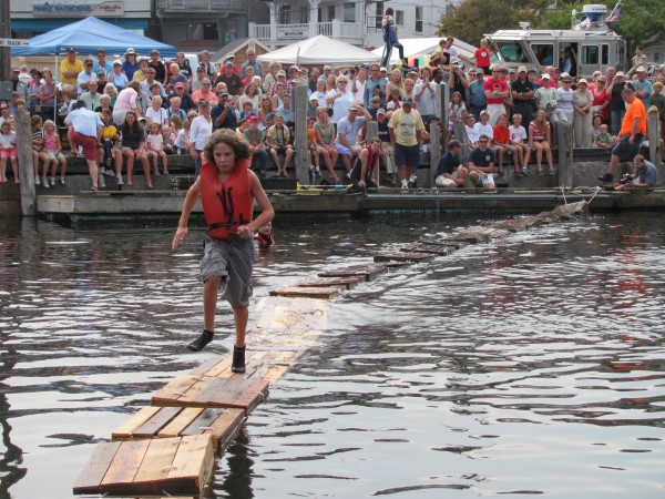 Aidan Acosta, 13, of Rockport, hurries to the end of a line of empty lobster crates Saturday, Sept. 3, 2011, at the Camden Windjammer Festival's lobster crate races. Acosta said it was his fist time competing in the event.