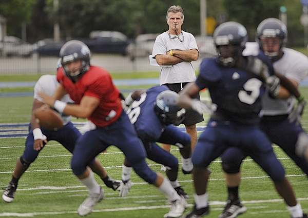 University of Maine head football coach Jack Cosgrove watches his Black Bear team in an intrasquad scrimmage two weeks ago at Alfond Stadium in Orono. The Black Bears open at home Saturday at 5 p.m. against Bryant University.