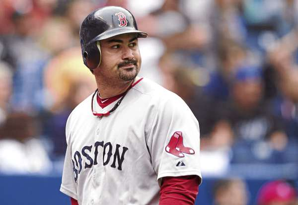 Boston Red Sox's Adrian Gonzalez reacts after striking out in the fourth inning against the Toronto Blue Jays in Toronto Monday, Sept. 5, 2011. The Blue Jays defeated the Red Sox 1-0 in 11 innings.