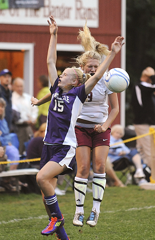 Bangor High School's Alex Malarky (right) goes up for a header along with Waterville's Sarah Shoulta during the first half of the game Tuesday evening.