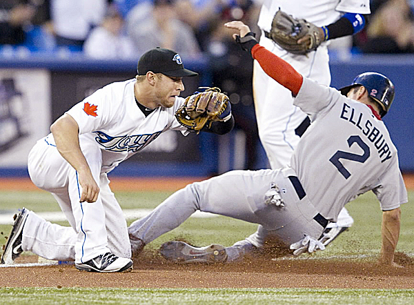 Jacoby Ellsbury (2) of the Boston Red Sox slides safely under the tag of Toronto Blue Jays third baseman Brett Lawrie during the second inning of Tuesday night's game in Toronto. The Red Sox won 14-0.