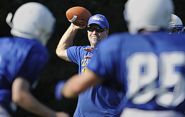 Hermon High School coach Ken Frederick conducts a passing drill during a preseason football practice. Hermon plays its first varsity home game Friday at 7 p.m. against Washington Academy of East Machias.