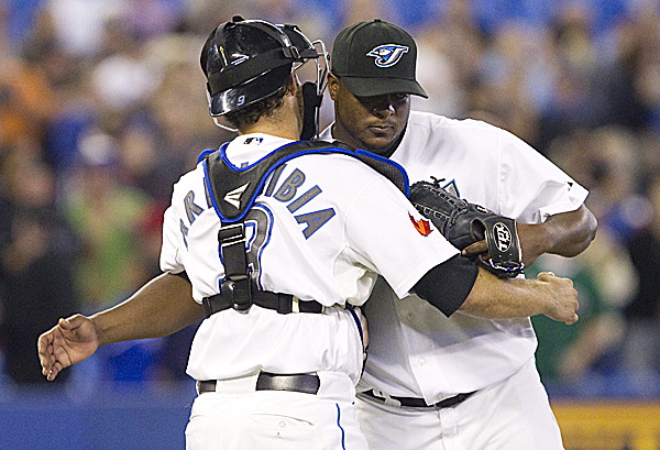 Toronto Blue Jays' Frank Francisco, right, and J.P. Arencibia celebrate their 7-4 victory over the Boston Red Sox in MLB action against the Boston Red Sox in Toronto, Thursday, Sept. 8, 2011. The Blue Jays defeated the Red Sox 7-4.