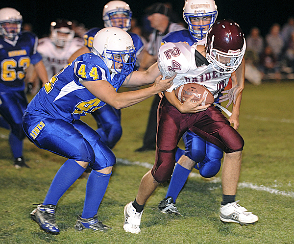 Hermon High School's Patrick Littlefield tackles Washington Academy's Andrew Henderson during the second quarter in Hermon Friday evening. Hermon won 21-16.