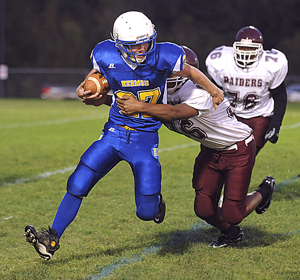 Hermon High School's David Shepardson scrambles for more yardage as he is tackled by Washington Academy's Tehon Fox during the second quarter in Hermon Friday evening.