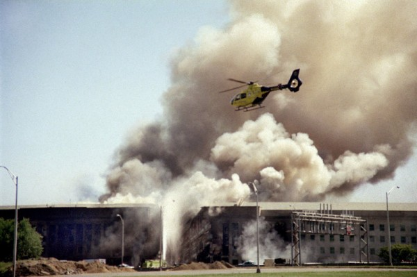 A helicopter flies over the Pentagon on Sept. 11, 2001, as smoke billows over the building following the crash of American Airlines Flight 77, which claimed 184 lives.