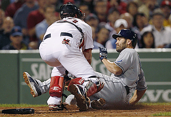 Boston Red Sox catcher Jason Varitek, left, tags out Tampa Bay Rays Johnny Damon, who tried to score on a ball hit by John Jaso during the fourth inning at Fenway Park in Boston Thursday night Sept. 15, 2011.