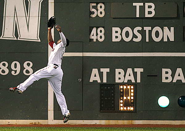 Boston Red Sox left fielder Carl Crawford makes a leaping catch on a line drive to the warning track by Tampa Bay Rays' B.J. Upton during the fifth inning at Fenway Park in Boston Thursday night, Sept. 15, 2011.