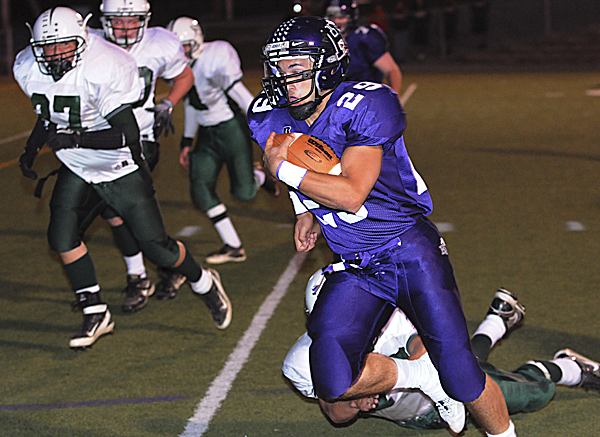 Hampden's Logan Steward takes the ball into the end zone against Old Town during first-quarter action on Friday night, Sept. 16, 2011 at Hampden. Hampden won 62-30.