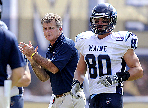 Maine head coach Jack Cosgrove (left) celebrates after Derek Buttles (80) scored a touchdown against Pittsburgh on Sept. 10. Pitt beat Maine 35-29, but Maine responded the next Saturday with a 31-15 win over Albany and is 2-1 entering its bye week.