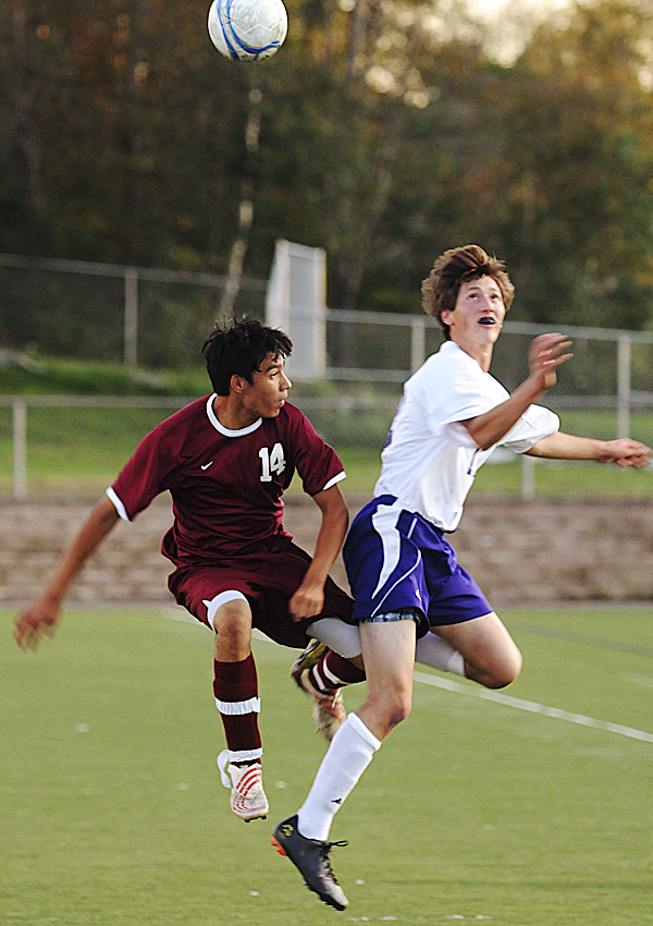 Bangor's Bobby Winchell (left) and Hampden's Ben Clark collide while attepting to gain control of the ball on Monday, September 19, 2011 at Hampden.
