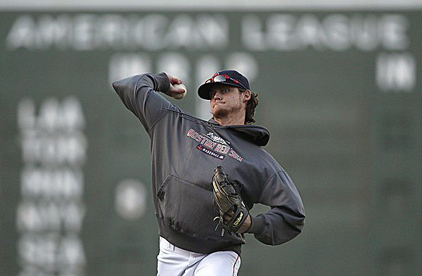 Boston Red Sox pitcher Clay Buchholz throws long toss as he works out prior to the second baseball game of the Red Sox's doubleheader against the Baltimore Orioles at Fenway Park in Boston, Monday Sept. 19, 2011. Buchholz, who is currently on the disabled list, threw 32 pitches in a simulated game Tuesday.