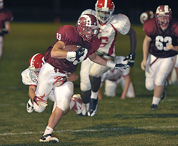 Bangor's Cody Chapman (33) slips into the end zone for the score in the first quarter of their game against Cony at Cameron Stadium in Bangor Friday, Sept. 23, 2011.