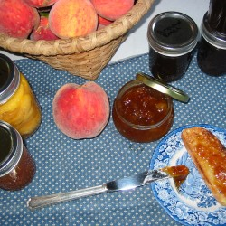 Brandied peach jam on toast with peaches.