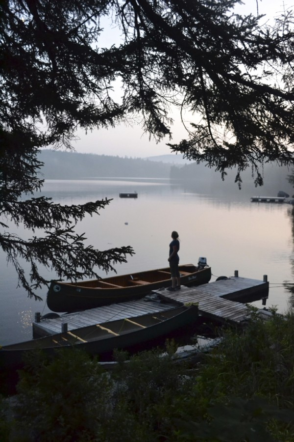 A young camper admires the view from the dock on Fourth Debsconeag Lake.