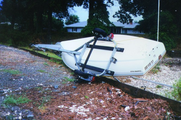 For protecting small boats like this in a hurricane, BoatUS recommends storing inside, or placing them on the ground and filling up with water.