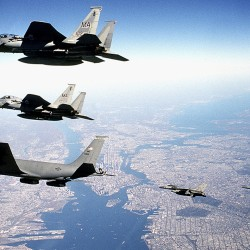 One of Maine's 101st Air Refueling Wing KC-135 Stratotankers (lower left) flies with other military craft it refueled above Manhattan shortly after the terrorist attacks of Sept. 11, 2001.