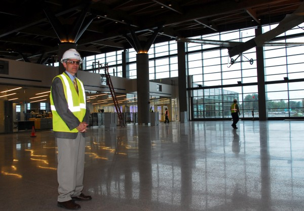 Airport Director Paul Bradbury shows off the vast space in the new security gate area at the expansion of the Portland International Jetport on Sept. 9, 2011.