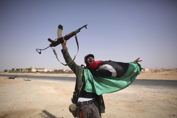 A Libyan fighter celebrates in Bani Walid, Libya on Friday, Sept. 16, 2011.