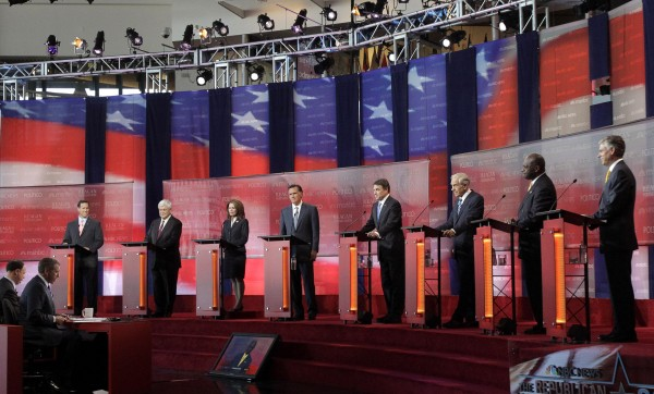 Republican presidential candidates (from left) former Pennsylvania Sen. Rick Santorum, former House Speaker Newt Gingrich, Rep. Michele Bachmann, R-Minn., former Massachusetts Gov. Mitt Romney, Texas Gov. Rick Perry, Rep. Ron Paul, R-Texas, businessman Herman Cain and former Utah Gov. Jon Huntsman stand at the podium to answer questions during a debate at the Reagan Library on Wednesday, Sept. 7, 2011, in Simi Valley, Calif.