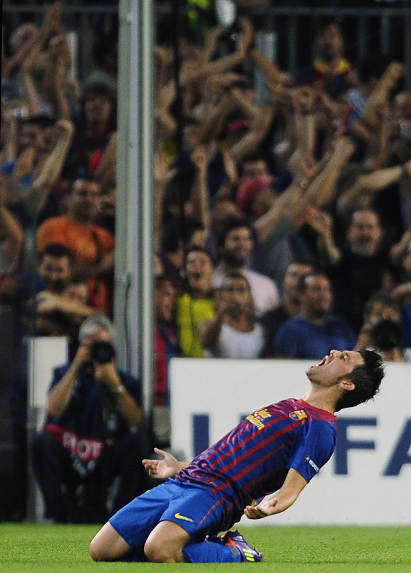FC Barcelona's David Villa reacts after scoring against AC Milan during their Champions league soccer match at the Nou Camp stadium in Barcelona, Spain, Tuesday, Sept. 13, 2011.