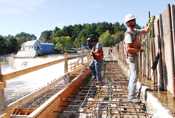 Bancroft Contracting employees work on a hydrodam project on the Androscoggin River north of Auburn.