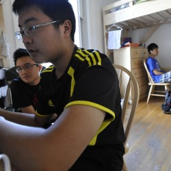 Sophomore George Sun (foreground), 16 of  the Jiangsu Province of China, senior Minh Le, 17 of Ho Chi Minh City, Vietnam and sophomore Tony Zhang,right, 16 of the Hebei Provice of China work on their math and science homework in their John Bapst Memorial High School dorm building on Broadway in Bangor SUnday afternoon, Sept. 25, 2011. This is the first year of the John Bapst's new international student program with 39 students from China, South Korea and Vietnam living in the school's recently purchased buildings.