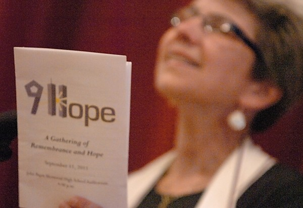 Holding up the event program, Rev. Stephanie Salinas of the First Baptist Church of Bangor, delivers the opening reflection during the Gathering of Remembrance and Hope at John Bapst Memorial High School Sunday afternoon, Sept. 11, 2011. The event brought together local clergy and other residents of various faiths to reflect on the events shaped by the Sept. 11 attacks ten years ago.