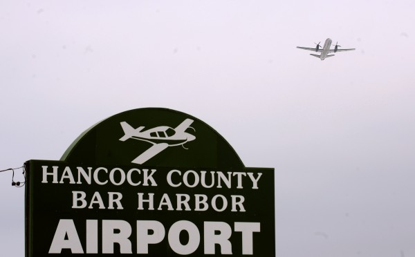A plane takes off from Hancock County-Bar Harbor Airport in February.