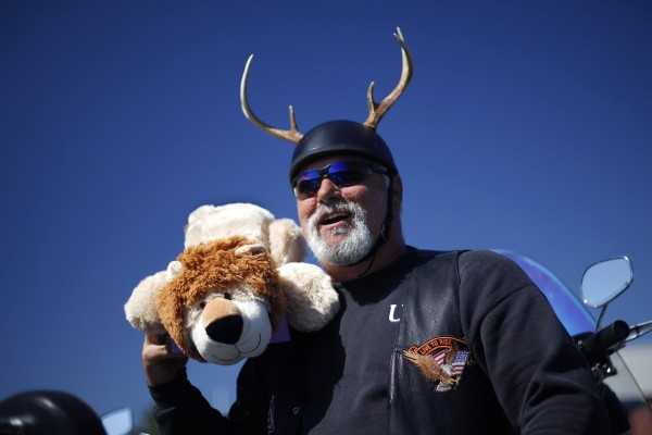 """Santa needs his reindeer,"" said biker Ed Caron, of Topsham, explaining the antlers on his helmet. He donated a stuffed lion."