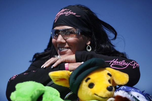 Biker Tammy Porter of Gardner poses with some of the stuffed animals she donated following the toy run.