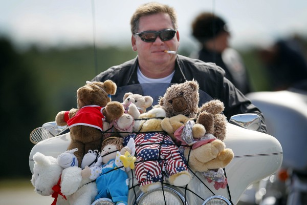 Ron Vachon of Winslow poses on his bike covered with stuffed animals before leaving the Augusta Civic Center on the toy run.