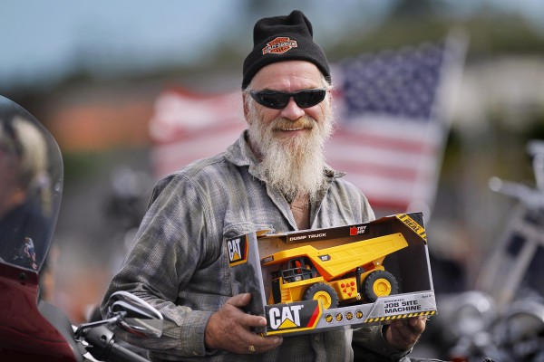 Harley-Davidson riker Mike Richards of Farmington donated a dump truck to be given to a needy child at Christmas.